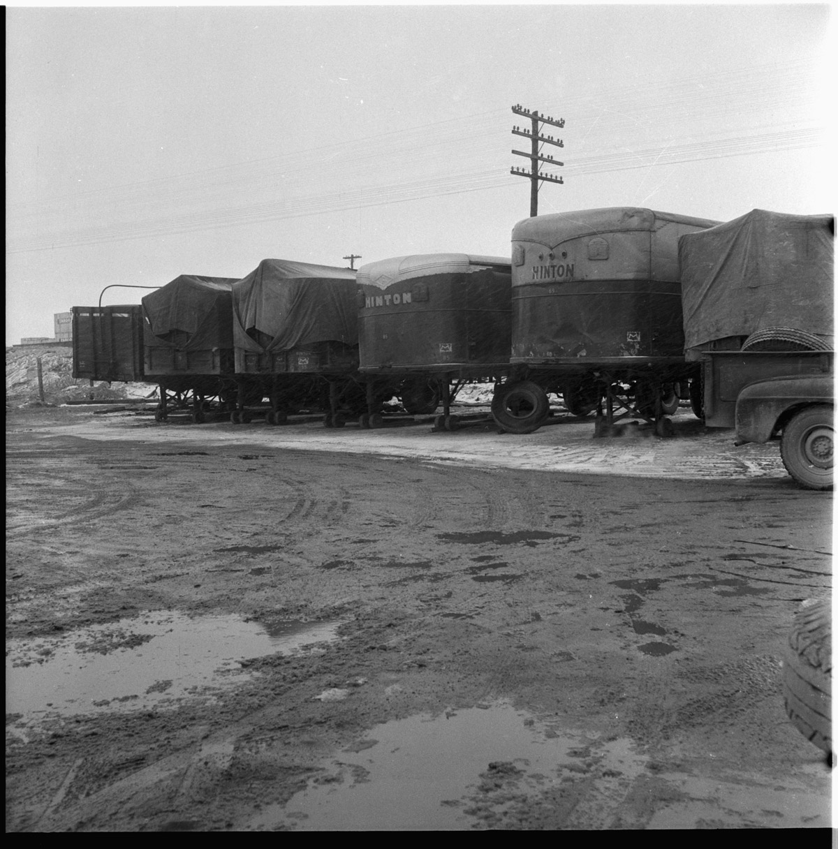 Line of transport trailers withe their covering tarps burned.