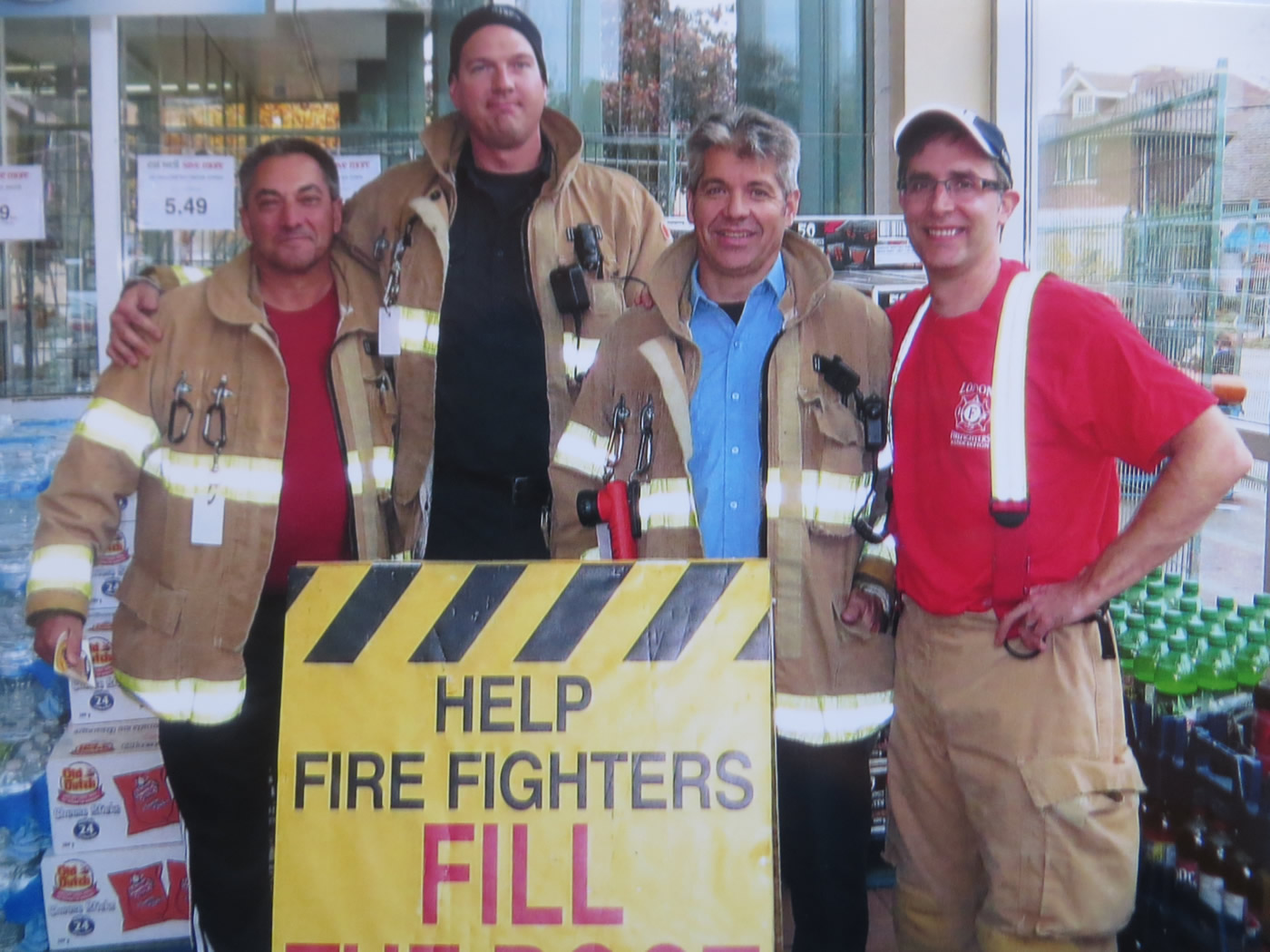 Four fire fighters taking a moment to pose for a photo at the annual MD Boot Toll